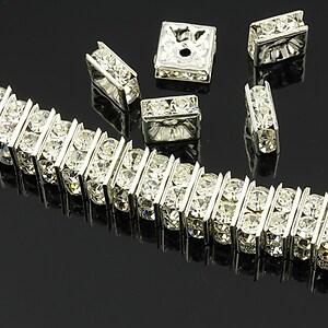 Distantiere argintii cu rhinestones albe 8mm (patrate 3,5x8mm)