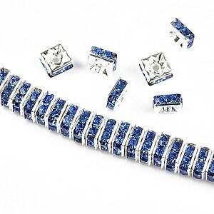 Distantiere argintii cu rhinestones albastre 6mm (patrate 2,5x6mm)