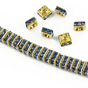 Distantiere aurii cu rhinestones albastre 6mm (patrate 2,5x6mm)
