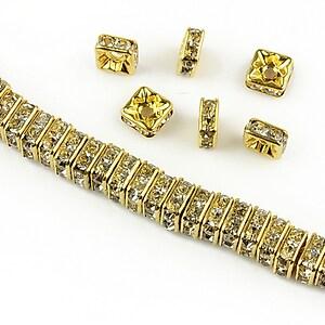Distantiere aurii cu rhinestones albe 6mm (patrate 2,5x6mm)