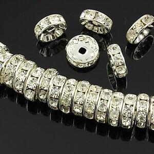 Distantiere argintii cu rhinestones albe 10mm (rondele 3,5x10mm)