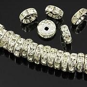 http://www.adalee.ro/22522-large/distantiere-argintii-cu-rhinestones-albe-10mm-rondele-35x10mm.jpg