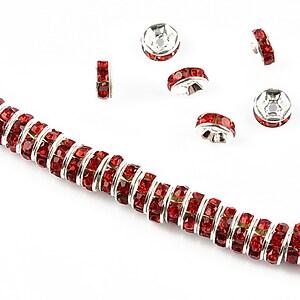 Distantiere argintii cu rhinestones rosii 6mm (rondele 2,5x6mm)
