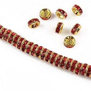 Distantiere aurii cu rhinestones rosii 6mm (rondele 2,5x6mm)