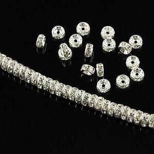 Distantiere argintii cu rhinestones albe 4mm (rondele 2x4mm)