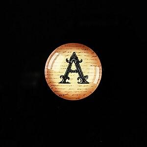 """Cabochon sticla 18mm """"Antique alphabet  - A"""" cod 353"""