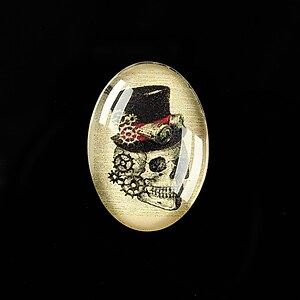 "Cabochon sticla 25x18mm ""Creepy Skull"" cod 411"