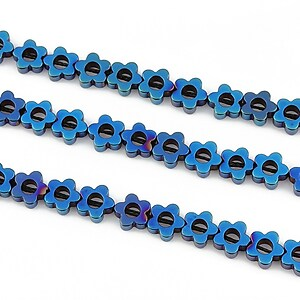 Hematit electroplacat floare 6mm - albastru