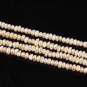 http://www.adalee.ro/67512-large/sirag-perle-de-cultura-roz-somon-rondele-aprox-2x3mm.jpg