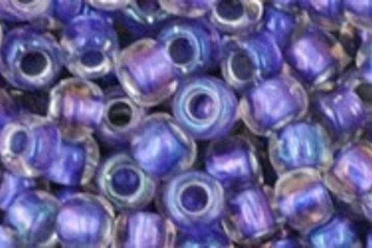 Margele Toho rotunde 6/0 - Inside-Color Rainbow Crystal/Metallic Purple Lined
