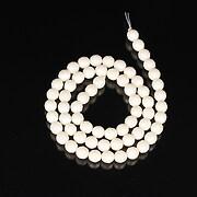 Sirag coral alb sfere fatetate 6mm